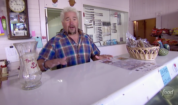 Fieri behind the counter at the Ferndale Meat Co. on his show Diners, Drive-ins and Dives. - FOODNETWORK.COM