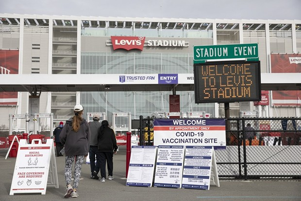 Patients enter Levi's Stadium to receive Pfizer COVID-19 vaccines on Feb. 9 2021 in Santa Clara. - PHOTO BY ANNE WERNIKOFF, CALMATTERS