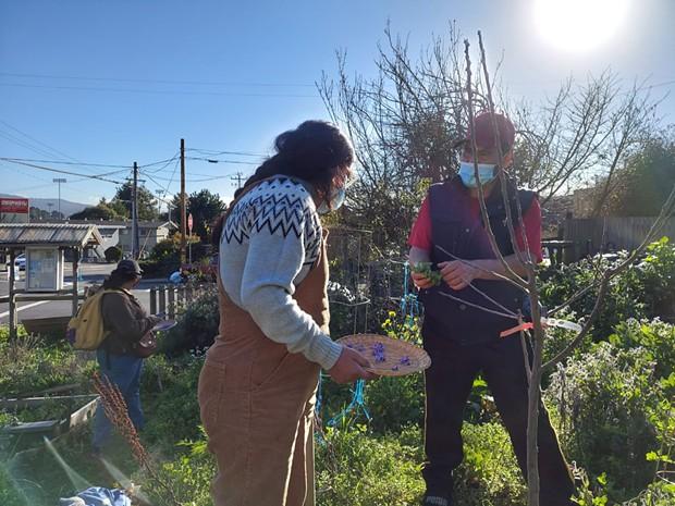 Brenda Perez with Adan Cervantes Perez at a community garden. - CENTRO DEL PUEBLO