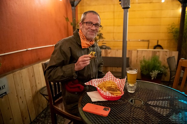 Enjoying Brabant fries and a grilled cheese under the Shanty's patio heat lamp. - PHOTO BY MARK MCKENNA