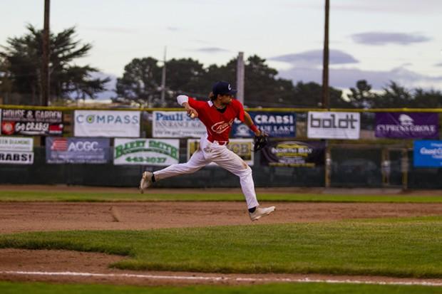 Crabs infielder David Morgan (#20) makes a play on a ground ball at third base on June 12, 2021 while facing Seals Baseball at Arcata Ballpark. - THOMAS LAL