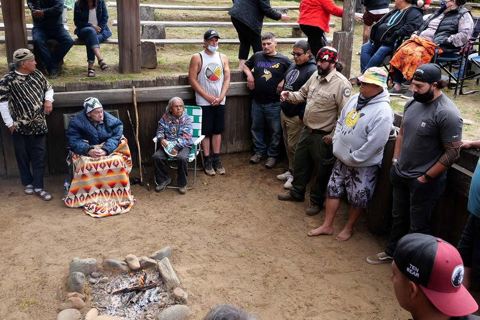 Among those honoring Tripp is Yurok State Parks Interpreter Skip Lowry, a friend and student of Tripp's who helped make the event at Sumeg Village happen. - PHOTO BY THOMAS DUNKLIN