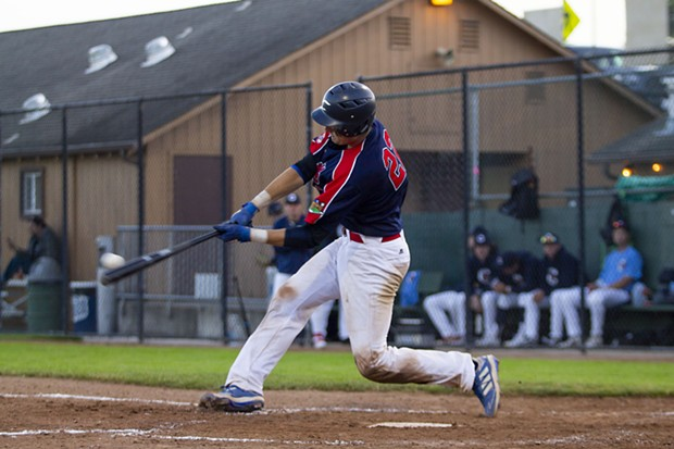 Crabs catcher Andrew Allanson (#22) makes contact with a pitch while facing the Seattle Studs on June 17, 2021 at Arcata Ballpark. Allanson finished the night with three hits, three runs and one RBI. - THOMAS LAL