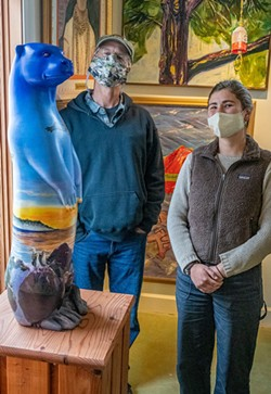 Michelle Kunst, program and project organizer at the Land Trust, joined Jeff Black to look over Maureen McGarry's otter location. - MARK LARSON