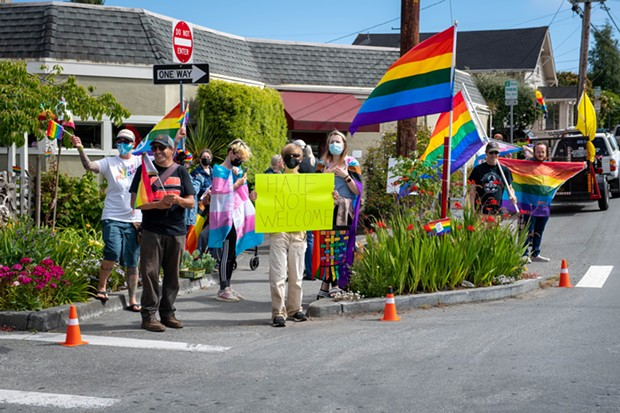 About a dozen people came out to fight hate on the corner of H and 18th streets in Arcata on Friday after posts on Nextdoor and social media told of a Pride Flag that was displayed in a garden on the same corner had been burned. - MARK MCKENNA
