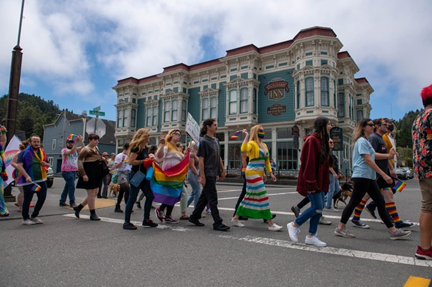 The march went down Main Street and back, and stopped at the church with the anti-LGBTQ sign. - PHOTO BY MARK MCKENNA