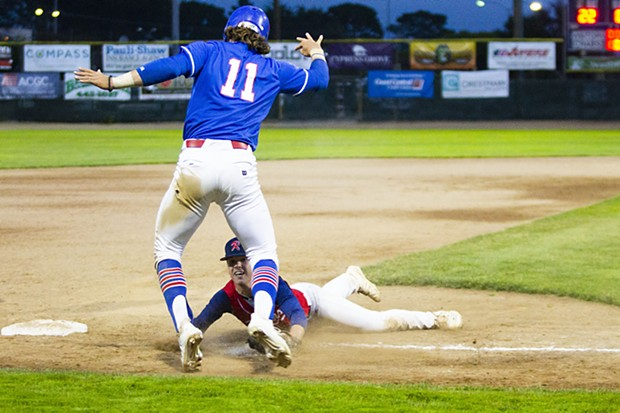 Crabs outfielder Josh Lauck (#11) attempts to scramble back to third base on June 23, 2021 while facing the Redding Tigers at Arcata Ballpark. - THOMAS LAL
