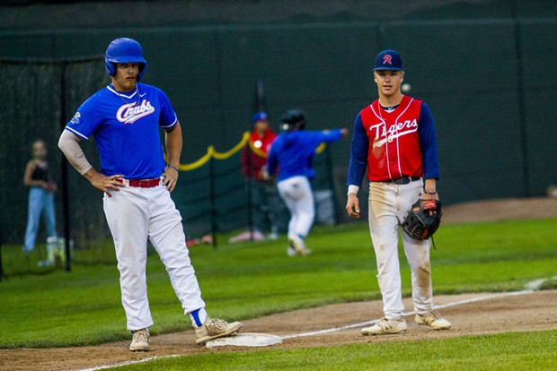 Crabs designated hitter and local Aidan Morris (#39) stands next to younger brother Keenan Morris playing third base for the Redding Tigers at Arcata Ballpark on June 23, 2021. - THOMAS LAL
