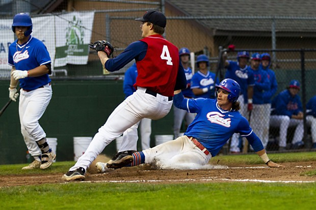 Crabs outfielder Josh Lauck (#11) slides into home to score off of a wild pitch against the Redding Tigers on June 23, 2021. - THOMAS LAL