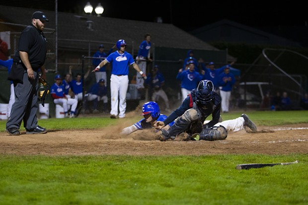 Crabs designated hitter Ethan Smith slides into home to tie the game in the bottom of the 10th inning while the Crabs take on the Redding Tigers at Arcata Ballpark on July 20, 2021 after the team gave up a six run lead in the top of the ninth inning. - THOMAS LAL