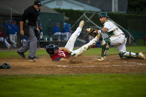 Crabs catcher Dylan McPhillips tags out a Redding Tigers runner at homeplate on July 21, 2021 on the way to a 6-4 Crabs win at Arcata Ballpark. - THOMAS LAL