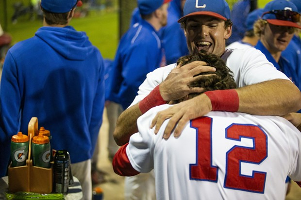 Crabs first baseman Gabe Giosso hugs second baseman Ethan Fischel in the dugout after the pair hit back to back home runs in the bottom of the eighth inning on July 21, 2021 at Arcata Ballpark. - THOMAS LAL