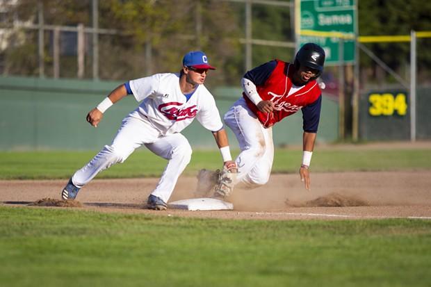 Crabs third baseman Konner Kinkade Tags out a Redding Tigers runner at third base on July 21, 2021. - THOMAS LAL