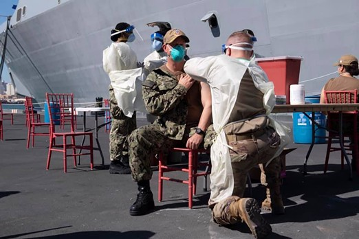 Vaccinations were given pierside to the USS San Diego's crew and embarked Marines in March. - U.S. NAVY