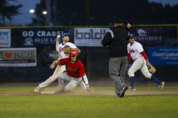 Crabs shortstop Aaron Casillas throws the ball over to first base after making the play at second for an out while facing the Alaska Goldpanners on Aug. 4, 2021 at Arcata Ballpark. - THOMAS LAL
