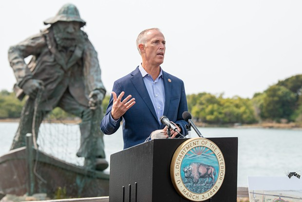 Congressman Jared Huffman answers a question from the media during a press conference about offshore wind power at the Woodley Island Marina on Tuesday. - MARK MCKENNA