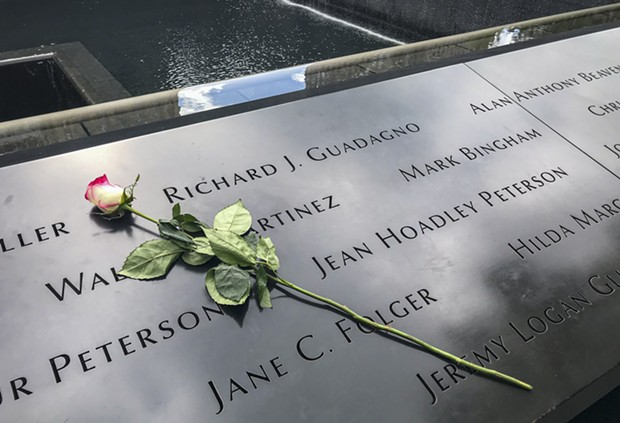 A single rose sits by Richard Guadagno's name at the 9/11 Memorial in New York City in 2019. - PHOTO BY MARK LARSON