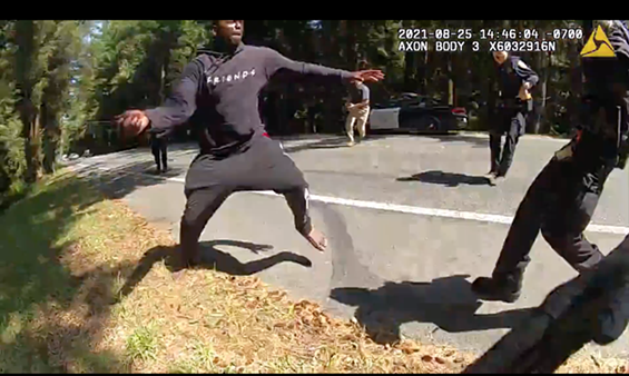 The video shows Robert Anderson picking up the knife and lunging with it at officers before running down the street toward a woman at the scene, at which point officers fatally shot him. - SCREENSHOT