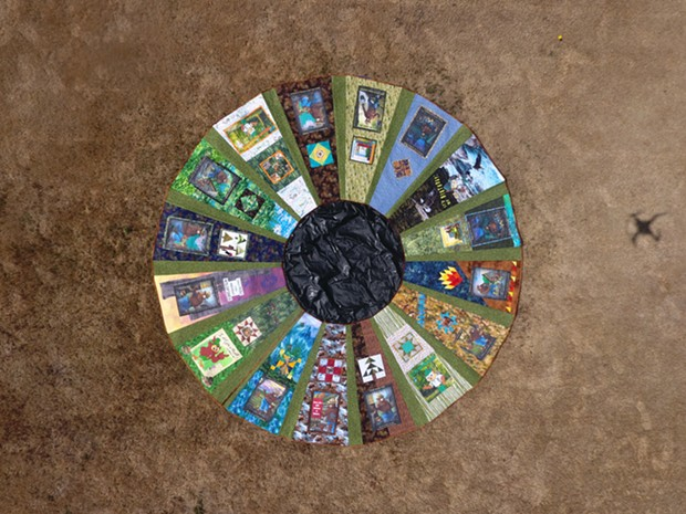 """A drone shot of the 15-foot """"Smokey, Woddsy and the Quilter's Trail"""" quilt. - COURTESY OF MAGGIE STIMSON"""