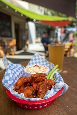 A half-order of wings and a Smokey Hazy Hemp IPA at Humboldt Brews. - JONATHAN WEBSTER