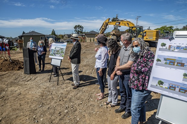 Kathy Moxon (second from left), ODCHC Board president, introduced board members Felicia Oldfather, Neal Sanders, Alison Talbott, Jay Molofsky (hidden), Lindsay Righter, John Driscoll and Connie Stewart (not pictured Sydney Fisher Larson and Heather Snow). They were standing near architectural drawings of the Arcata Communiity Health Center located between Foster and Sunset avenues. - MARK LARSON