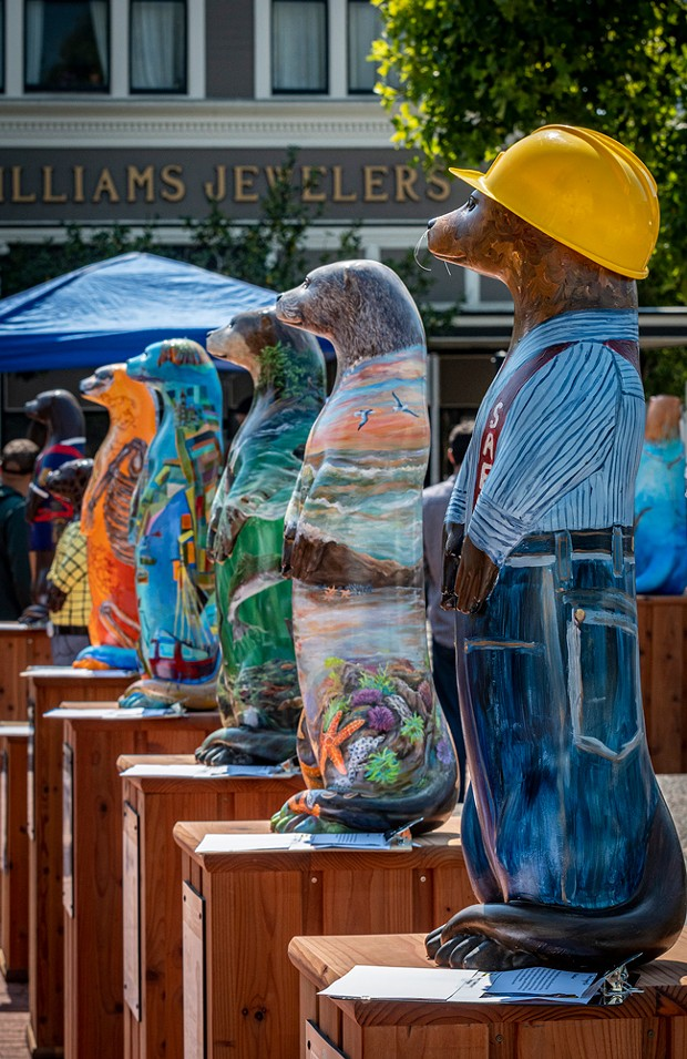 """Live In-Person Silent Auction, North Coast Otters Public Arts Initiative, Clarke Plaza, Eureka, Saturday, Sept. 11, 2021. (""""Johner the Logger Otter"""" by Claudia Lima in the foreground). - PHOTO BY MARK LARSON"""