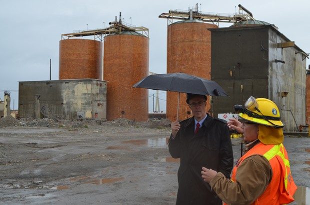 Jared Huffman speaks with an EPA representative under more literal rain at the Samoa Pulp Mill last year. - GRANT SCOTT-GOFORTH
