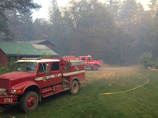 Cal Fire engines responded to defend the home of Collins and Lance. - JENNIFER LANCE