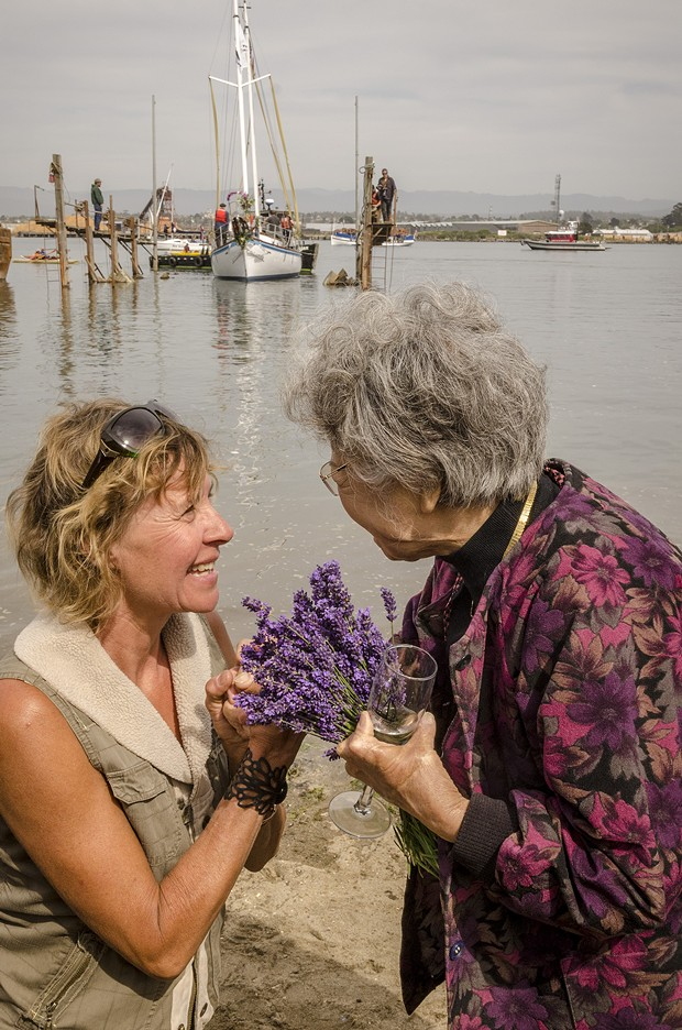 Chris Willrodt, of Comptche, greeted Hiroshima atomic bomb survivor Shigeko Sasamori after  the launching of the Golden Rule on Saturday, June 20 at the Zerlang & Zerlang  boat yard on the Samoa peninsula. - MARK LARSON