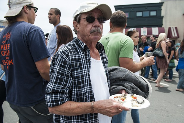 Shuck it forward: A total stranger handed  a plate of oysters to Dan Becker of Roseburg, Oregon. - MARK MCKENNA