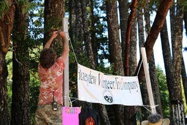 Volunteers set up for the Roll. - JENNIFER SAVAGE