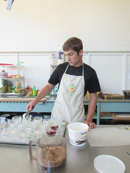 Local high-schooler John Georgia volunteers for the program, earning his food handlers certificate. - LINDA STANSBERRY