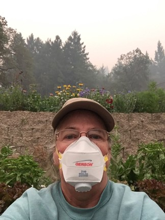 Dottie Simmons of Simmons Natural Bodycare wears a specialty protective mask to garden at her home in Dinsmore. - DOTTIE SIMMONS