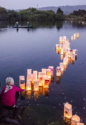 Lanterns float out onto Klopp Lake during the 33rd annual ceremony. - MARK LARSON