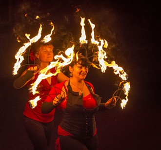 Circus of the Elements performers Loreta Flemingaite (left), of McKinleyville, and Chakeeta Marie Garabedian, of Trinidad, fire-dancing at Elemental: An Outdoor Pageant Spectacle. - MARK LARSON
