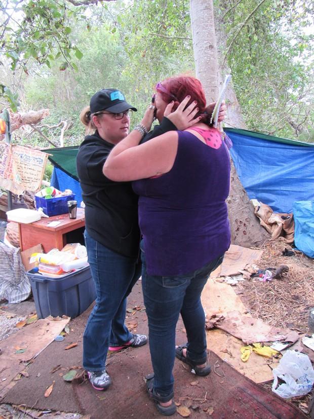 Betsy Totten comforts Kathleen Hytholt. - LINDA STANSBERRY