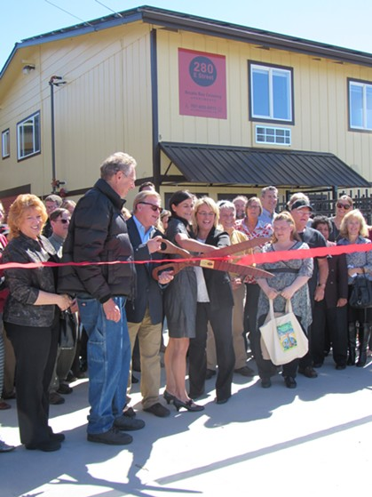 Arcata Mayor Michael Winkler, Beth Matsumoto of Humboldt Bay Housing Development and others prepare to cut the ribbon. - LINDA STANSBERRY