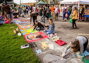 Pastel artists hard at work on the plaza sidewalks. - MARK LARSON