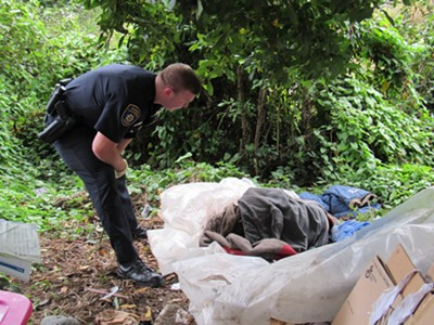 EPD officer contacts a homeless man camped in greenbelt. - LINDA STANSBERRY