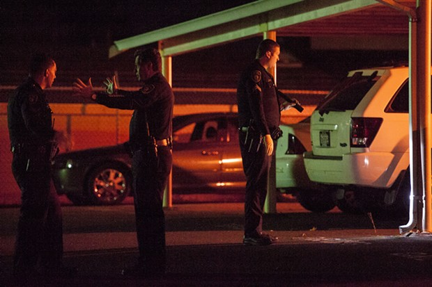 EPD Chief Andy Mills speaks with officers at the scene of Saturday's fatal shooting. - MARK MCKENNA