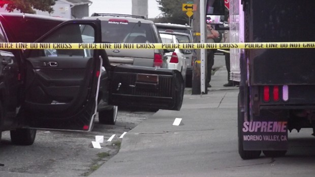 Crime scene tape cordons off the area of Sunday's shooting. - ROBERT KROEKER