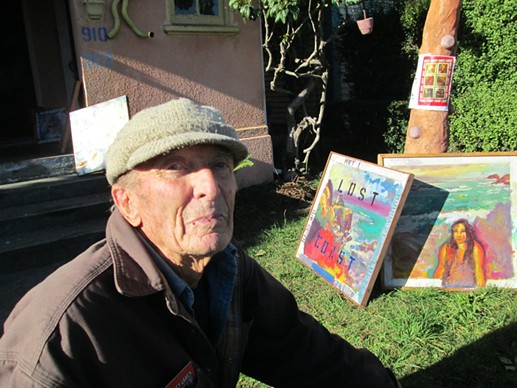 Otto in his yard among his paintings last winter. - JACK SEWELL