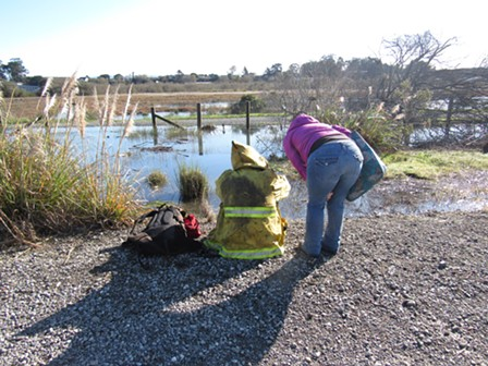 City Councilmember Kim Bergel checks in with a man camped in the PalCo Marsh. - LINDA STANSBERRY