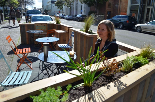 Jessica Cenotti sips on a coffee in the parklet outside Ramone's on a rare sunny February afternoon. - GRANT SCOTT-GOFORTH