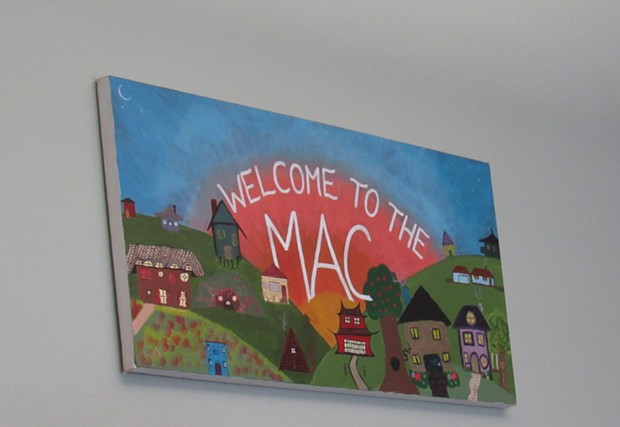 A sign welcoming visitors to the MAC. - LINDA STANSBERRY