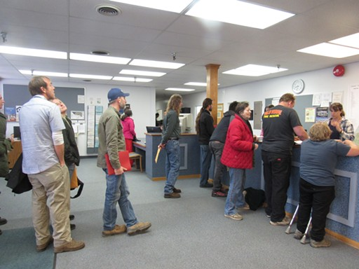 The first applicants of the day wait in line to submit their applications at the County Planning Department. - LINDA STANSBERRY