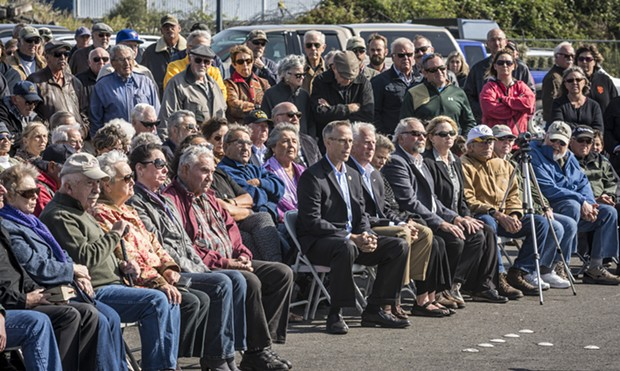 Congressmen Jared Huffman and Mike Thompson sit among the crowd that gathered to remember Jimmy Smith. - MARK LARSON