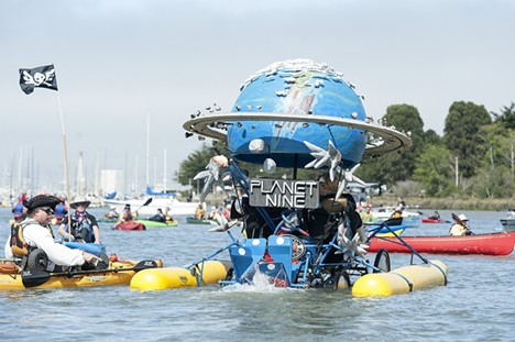 Planet Nine's cat people doggie paddle out on Humboldt Bay for the Kinetic Grand Championship on Sunday. - MARK MCKENNA