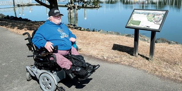 Charles Bean rolls down one of Eureka's waterfront trails. - MARK MCKENNA