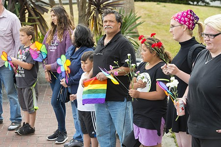 Adults and kids alike showed up for the vigil at the courthouse on Monday. - MARK MCKENNA